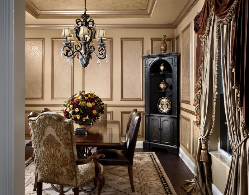 classic dining chairs in beige with textured motifs black leather dining chairs dark toned wood dining table black painted corner cabinet dark toned hardwood floors beige walls biege draperies