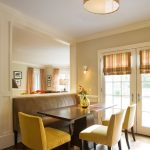 Contemporary Dining Room With Yellow French Dining Chairs Dark Finishing Dining Table Dark Toned Wood Floors Double Panel French Door