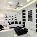 Contemporary Living Room White Sofas With Solid Black Throw Pillows Glossy Black Coffee Table In Square Shape Marble Floors Black And White Wall Ornaments Ceiling Fan