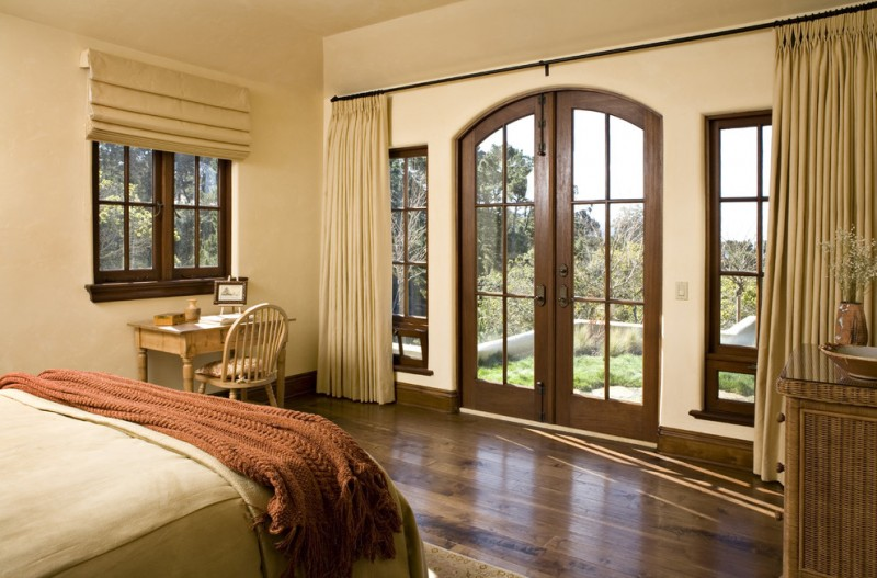 curtains for french doors arch french doors large curtain wood flooring brown comforter wooden desk and chair bed window with shade