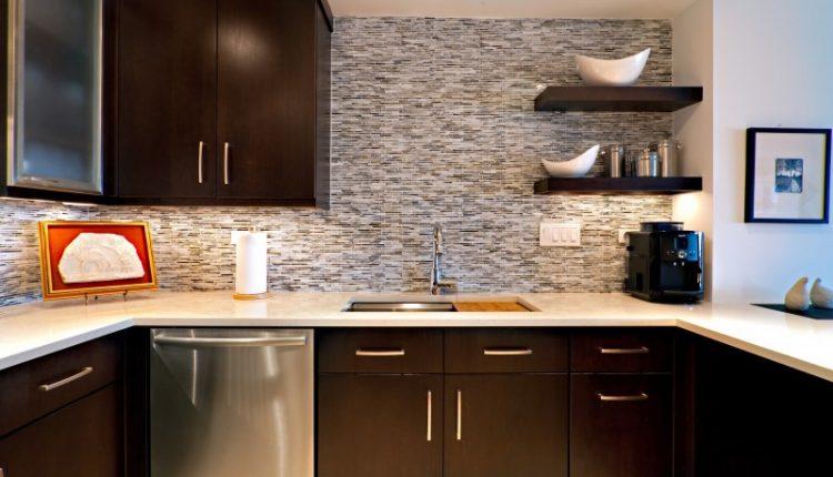 dark falt panel cabinet floating cabinet floating open shelves white countertop tiled backsplash recessed lights under cabinet lights