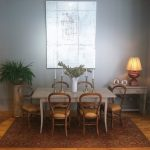 Eclectic Dining Room French Dining Chairs With Balloon Back And Beige Fabric Pale Toned Dining Table Pale Toned Corner Side Table Area Rug With Traditional Motifs Grey Walls Medium Toned Wood Floors
