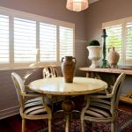 Eclectic Small Dining Room Round White Top Dining Table French Dining Chairs With Stripes Fabric Runner Rug With Motifs Dark Hardwood Floors