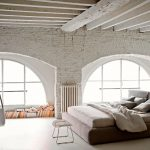 exposed beams swing chair contemporary beeding brick wall arched window bedroom lamp