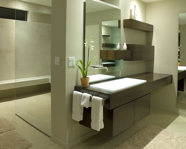 floating vanity dark vanity under mount sink bathroom rug wall mounted faucet mirror glass door