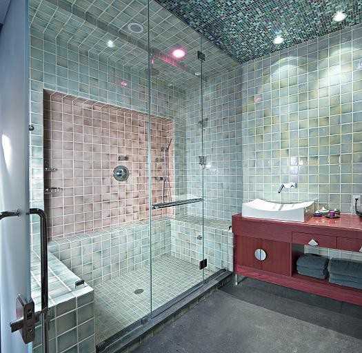frameless glass shower doors hand glazed tiles mosaic glass ceiling steam transom over door towel bar vessel sink wall mount faucet