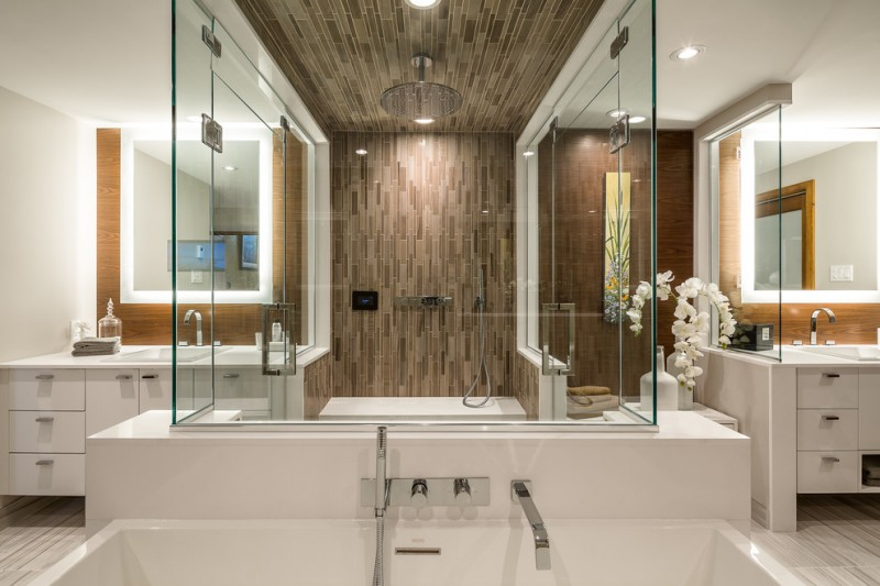 frameless glass shower doors shower area in the middle white vanities with storages ceiling tiles big head shower mirrors with lighting flower
