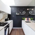 kitchen wall decor ideas black feature wall chalkboard dark wood flooring galley kitchen marble splashback mirror wall open shelf undermount sink