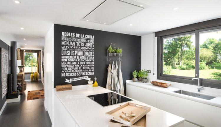 kitchen wall decor ideas permanent writing sliding glass window white kitchen cabinet black wall undermount sink plants trays