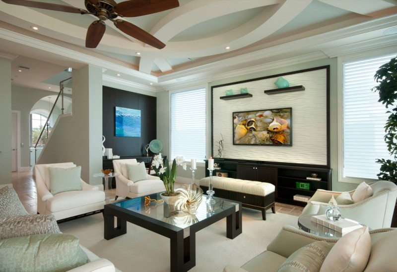 Large Transitional Living Room With Green Walls And A Wall Mounted TV  Wooden Hanging Fan Black