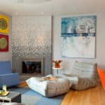 Living Room With Comfortable Lounge Chairs, Blue Chairs, Grey Sofa, Coffee Table With Shelves, Blue Rugs, Dining Set With White Table And Orange Plastic Chairs