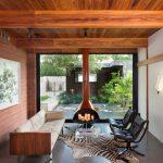 Living Room With Nude Sofa, Black Leather Chairs, Glass Coffee Table, Fireplace, Animal Print Rug