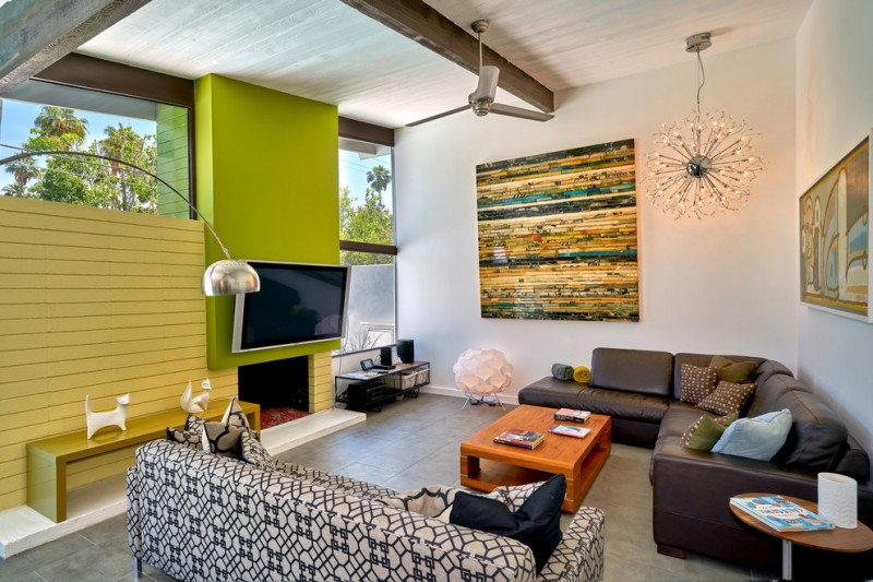 living room with white painted wall, yellow wooden wall and green plank, brown leather sofa, geometrical lines sofa, wooden coffee table