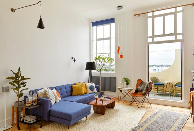 Living Roomwith Beige Rug, Orange Plastic Midcentury Chair, Blue Sofa,  Wooden Coffee Table