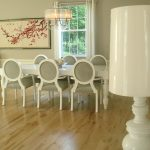 Modern Dining Room Idea White French Dining Chairs With Grey Upholstered Seating White Dining Table Pale Toned Wood Floors White Walls With Sakura Decorative Picture Modern Pendant Lamp