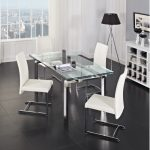 modern dining set with table with glass top stainless steel legs and chairs with white seating and stainless steel legs