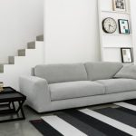 Modern Living Room Grey Sofa With Adjustable Head And Armrest Black And White Stripes Area Rug Modern Black Side Tables With X Base White Ladder Book Shelf