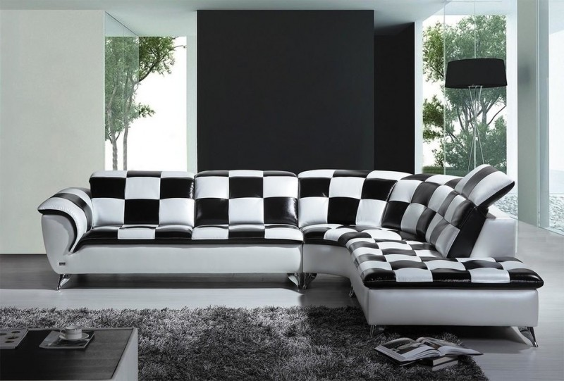 modern living room idea black and white sectional with adjustable headrest grey area rug black walls white walls frameless glass windows and door
