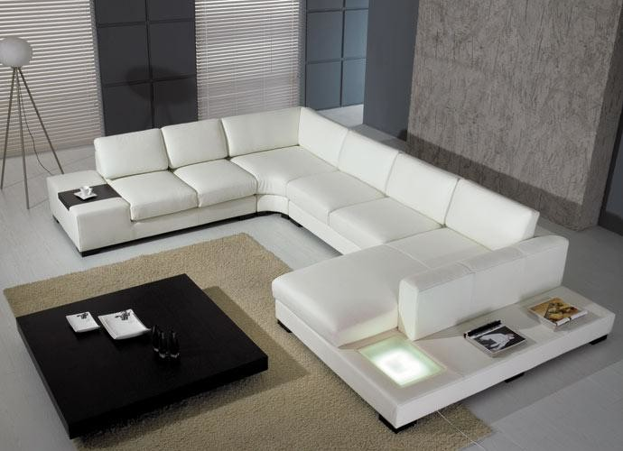 modern living room idea white sectional with extra wide chaise pad cream colored area rug black finished oak center table modern floor lamp