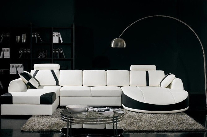 modern living room modern white chaise with black accent light grey area rug glossy black floors solid black wall round glass top center table