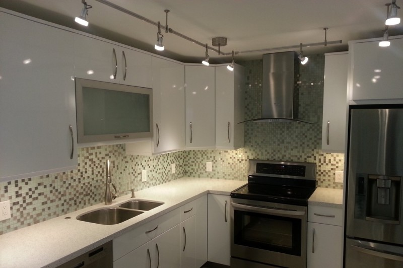 mosaic tiled backsplash flat panel cabinet white cabinet undermount sink stainless steel aplliances bar lights metal hood