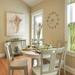 nude wooden dining set with small round table and four wooden chairs