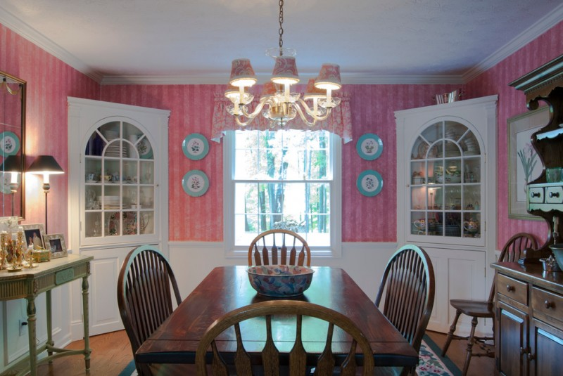 pink wallpaper built in corner cabinets in white wood dining table wood dining chairs traditional hall table in pale green pendant lamp with mini light cups