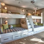 queen size bunk beds circle wall sconces industrial lighting built in stairs with storages wall decorations carpets a bench colorful stripe bed sheets