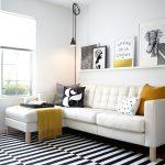 Scandinavian Living Room White Sofa With Black & White Throw Pillows White & Black Stripes Area Rug Single Shelf In White Wall Ornaments