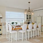 Shabby Chic Dining Room With White French Style Dining Chairs Medium Toned Wood Dining Table Kitchen Appliances With Soft Cream Finishing Ceramic Tiles Floors