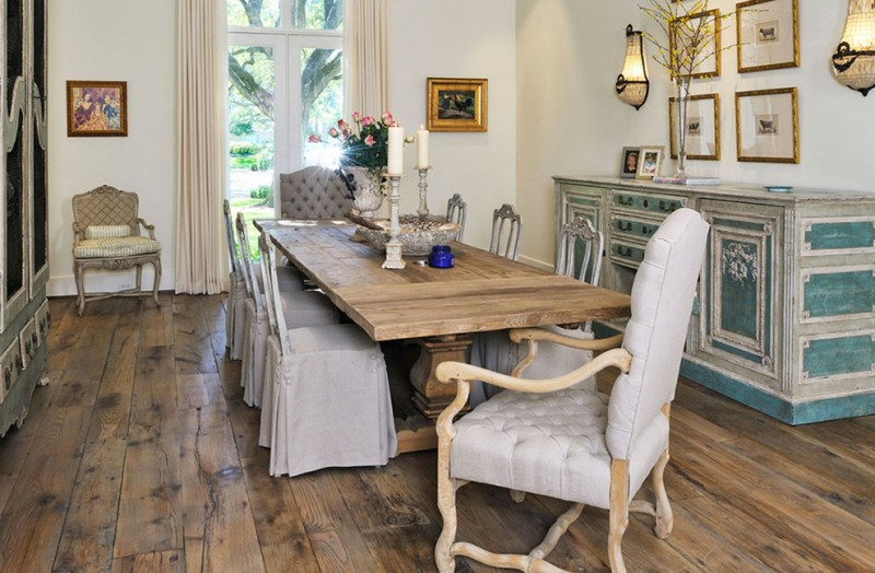 traditional dining room French dining chairs with grey upholstery and slipcover hardwood dining table without finishing original wood board floors without finishing white walls