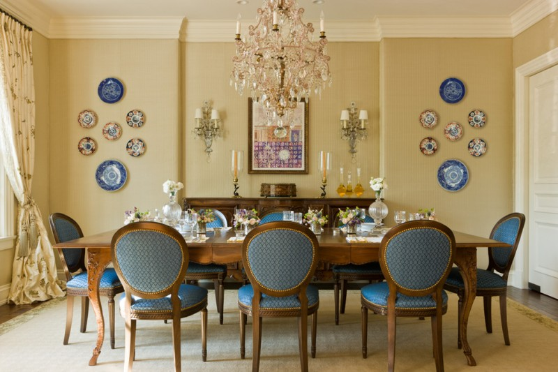 traditional dining room idea French style dining set with blue linen long hardwood end table hardwood hall console beige walls porcelain made decorative plates a pair of wall lamps crystal chandelier