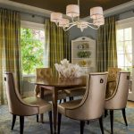 Traditional Style Dining Room Idea Dark Gold Toned Dining Chairs Round Shaped Wood Dining Table Blue Area Rug With Motifs Green Draperies White Traditional Pendant Lamp White Finishing Corner Cabinet