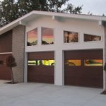 Velvet Garage Craftsman Garage White Siding Brick Wall Glass Window Paving