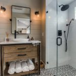 Walk In Shower Designs Patterned Black And White Floor Dark Showers Frameless Glass Door Wood Cabinet Mirror Traditional Wall Sconces Marble Countertop White Sink