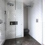 walk in shower designs two head showers frameless shower glass doors matte white brick wall design shalpoo shelf dark floor