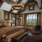 Rustic bedroom idea with beige walls and dark hardwood floors brass pendant lamp brown carpet beige sofa cream curtains wooden cabinet