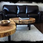 Black Leather Sofa Large Modern Tree Trunk Coffee Tables White Wool Area Rug Dark Toned Wood Floors Tree Trunk Side Tables