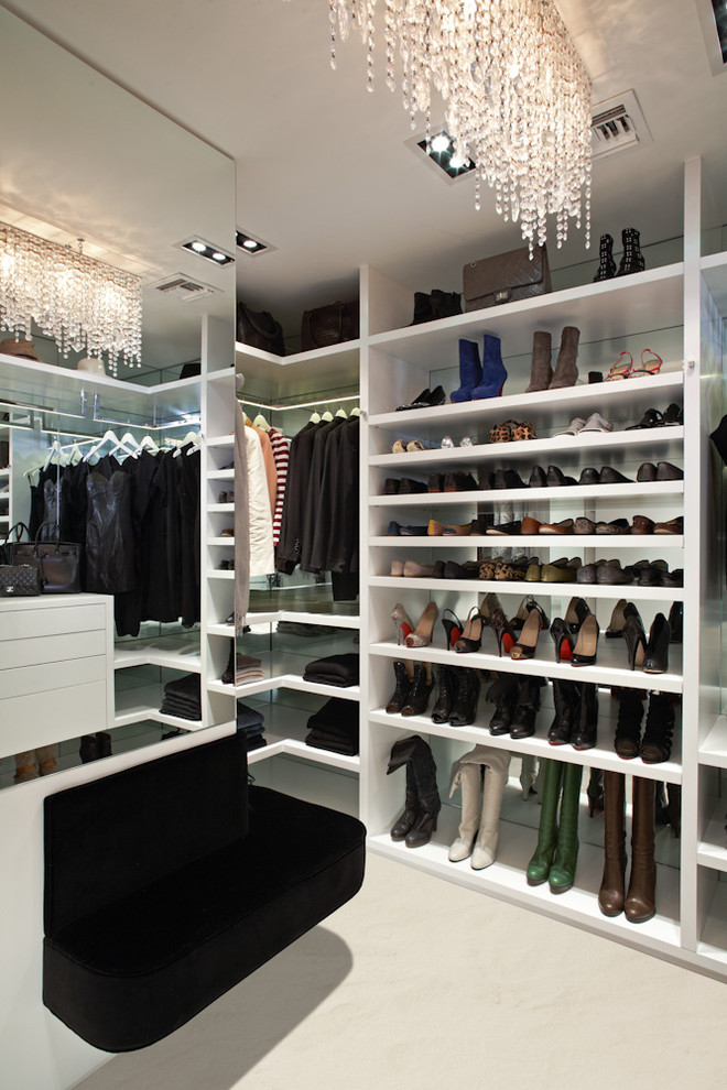 buil in closet seating mirrored siding shoe racks open shelves celing lightning hanging rods