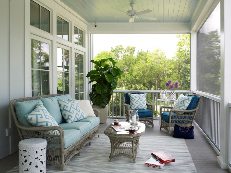 coastal style front porch seating with light blue throw pillows white side chair ceiling fan in white