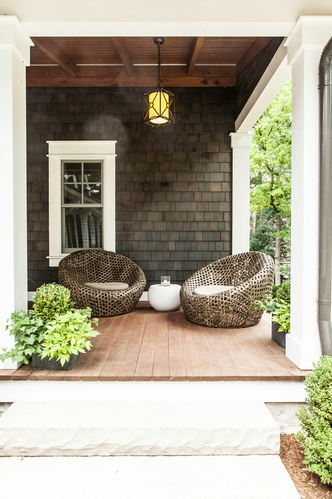 contemporary front porch idea shingle siding in shabby black rustic style hanging lamp Dark brown chairs with small white seating small white side table medium toned wood siding floors