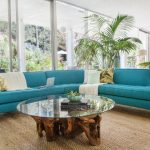 Eyecatching Blue Sectional Sofa In Curve Shape Round Shaped Glass Top Coffee Table With Tree Trunk Base Juted Area Rug