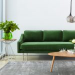 Fresh And Green Sofa With Downward Sloping Armrests Clear Finishing Side Table In Round Shape And Stainless Steel Wire Base Asymmetric Wood Coffee Table With Clear Finishing