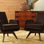 Mid Century Chairs With Modern Style In Dark Brown Light Brown Area Rug Dark Toned Wood Hall Console With Decorative Wood Ball Table Lamp
