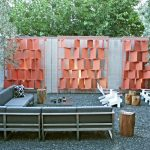 Modern Patio Idea Grey Sectional Sofa White Outdoor Chairs Salvaged Tree Trunk Tables Small Stones Floors Red Shade Like Salmon Cuts