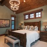 mountain style bedroom design with gray walls and carpet pendant lamp lamp table wooden tables wood trim and ceiling