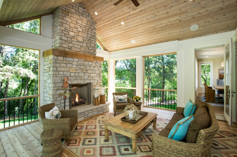 traditional front porch idea rattan chairs with accent pillows wood center table without finishing area rug with motifs outdoor fireplace with bricks surround