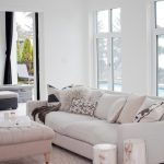 Whitewashed Tree Trunk Side Tables White Sofa White Tufted Ottoman Coffee Table White Area Rug With Motifs