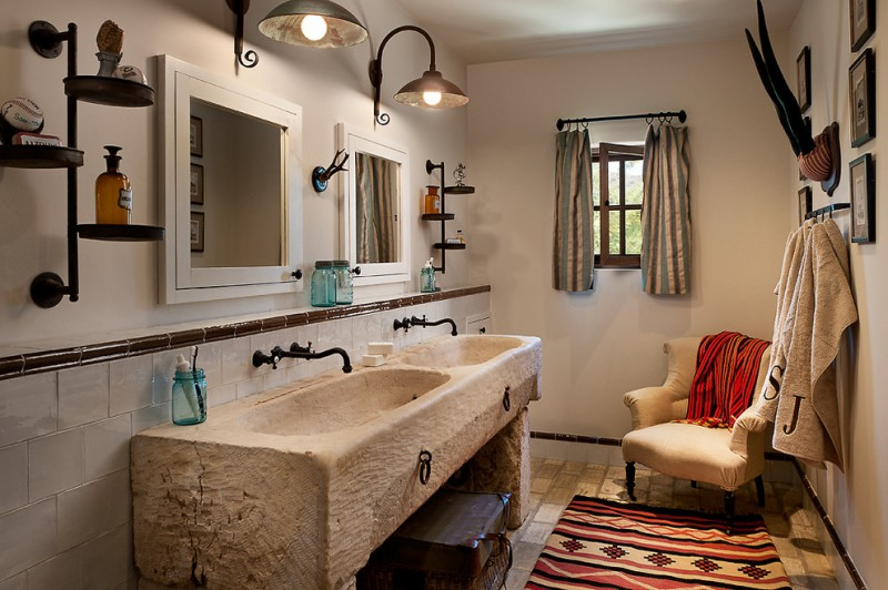 Mediterranean beige tile bathroom with an integrated sink accent curtain and rug concrete sink fixed lamp bathroom tile floors double rectangular mirrors