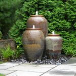 Three urn pottery water fountains with line details and color gradation